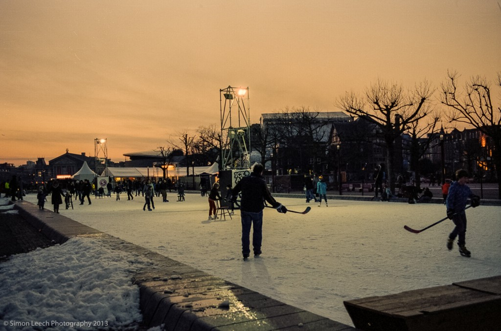 Ice skating on Museumplein. Every year the Museumplein is covered over with an artificial ice rink. At this point of the day the light was dropping off pretty quickly