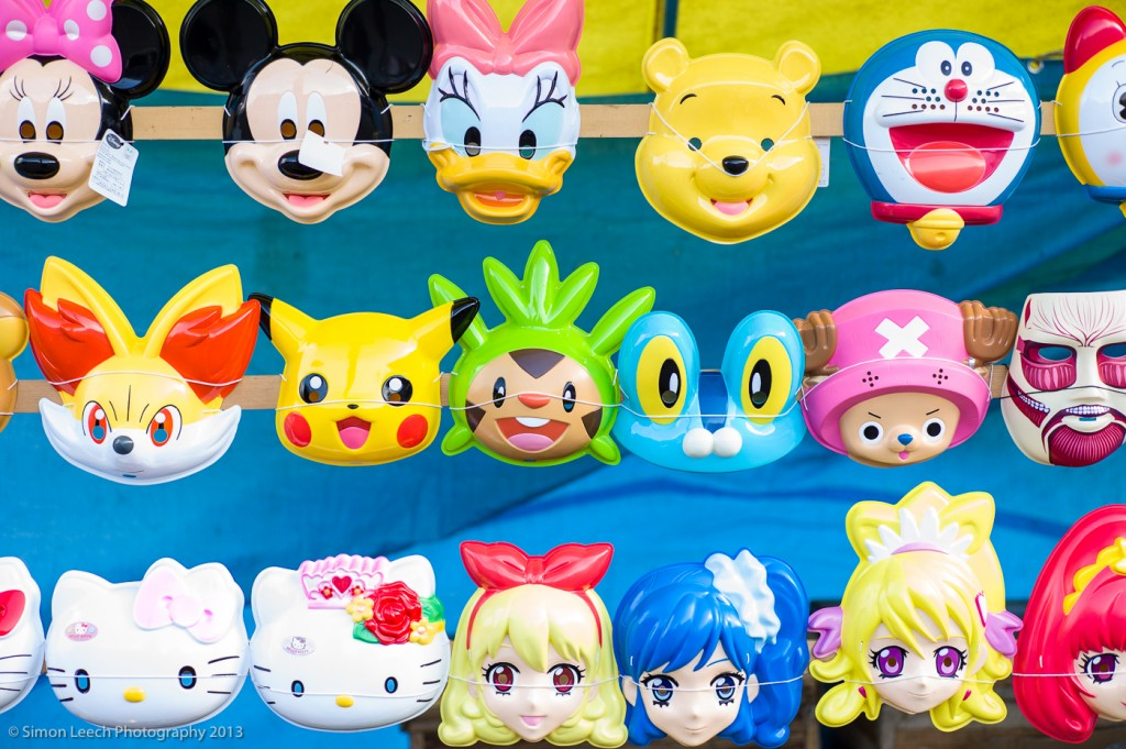 Face masks depicting a mix of Western and Far Eastern children's characters. Around the New Year period there are many street markets selling this sort of thing