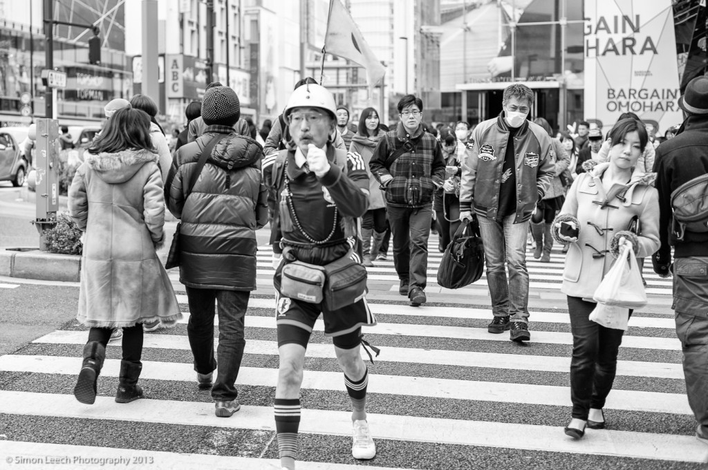 Saving the world, one step at a time. You meet some odd people in Tokyo. He was a quick chap. Completely missed my focus.....